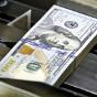 Межбанк: доллар упал на двойной порции отложенного с 21 и 24 декабря предложения СКВ